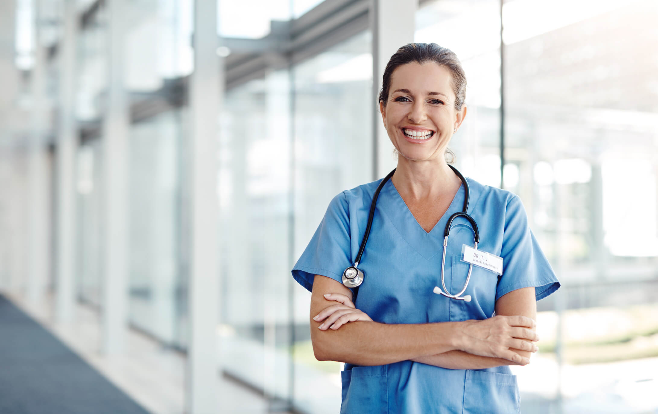 Shot of a female nurse standing confidently with her arms crossed